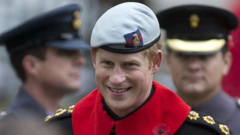 Britain's Prince Harry smiles as he chats with