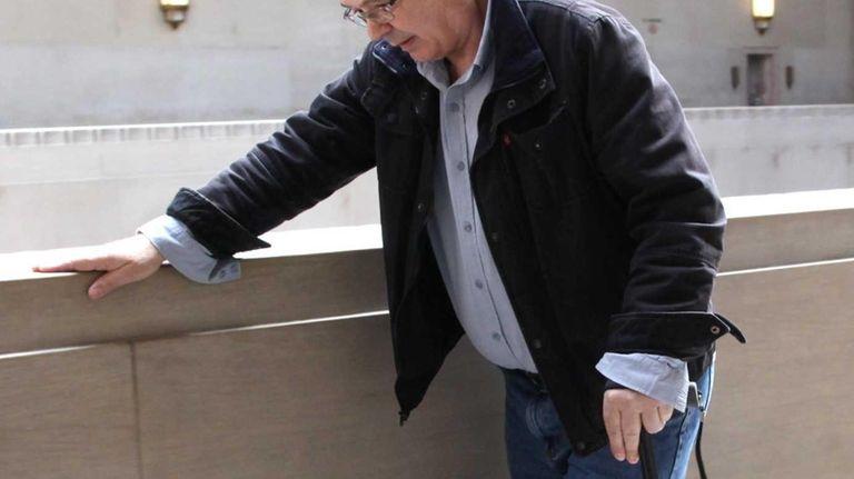 Louis Kragouras, 65, of Bethpage, leaves the Nassau