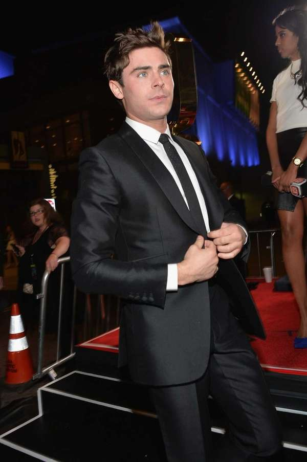 "Zac Efron arrives at the premiere of ""That"