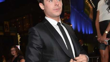 Zac Efron arrives at the premiere of