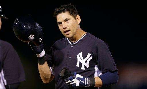 Jacoby Ellsbury walks off the field after grounding