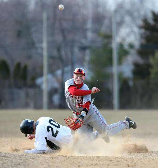 Patchogue-Medford shortstop Rich Ciufo tries to turn the