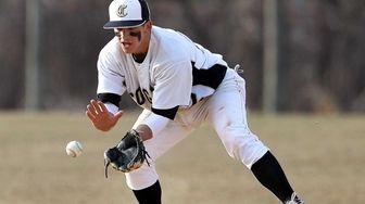 Commack shortstop Jesse Berardi grabs the ground ball