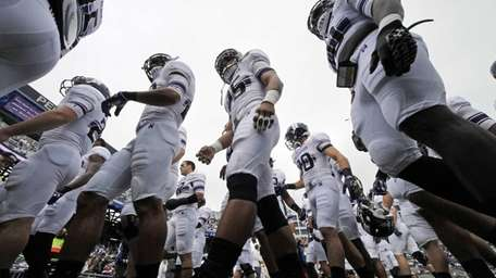 The Northwestern football team heads to the locker