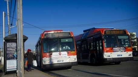 Nassau Inter-County Express buses take on passengers at