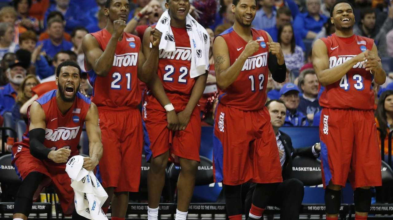 Dayton players celebrate a three-point shot against Stanford
