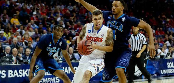 Scottie Wilbekin of the Florida Gators drives to