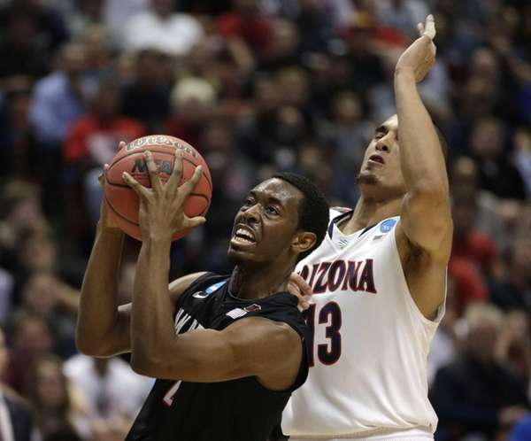 San Diego State guard Xavier Thames, left, drives