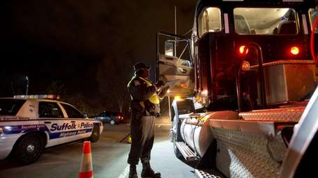 Law enforcement personnel operate at a multiagency gasoline