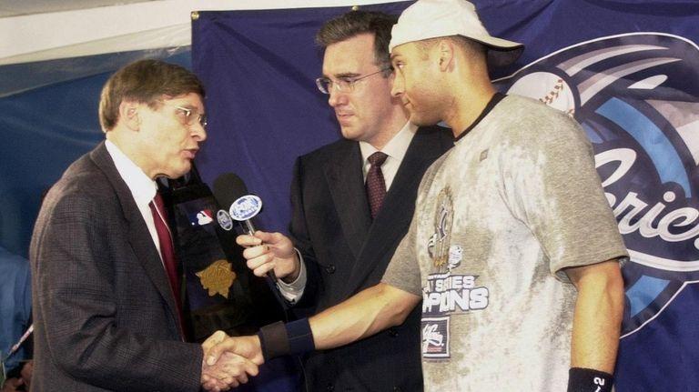 Derek Jeter is awarded the MVP trophy by