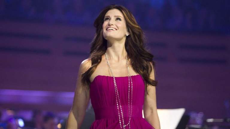 Idina Menzel, backed by an orchestra masterfully led