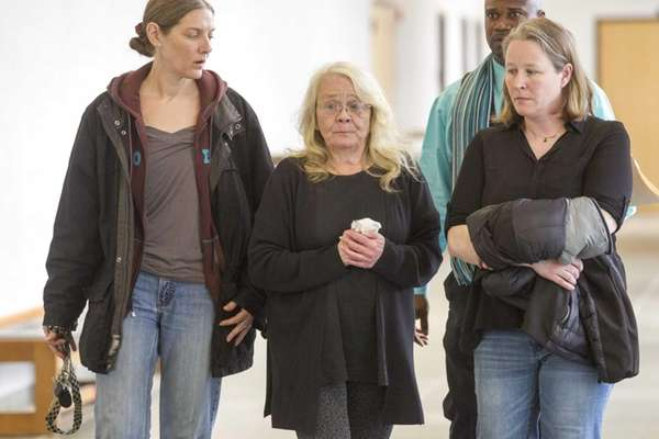 Former Southold Town court clerk Christine Stulsky, center,