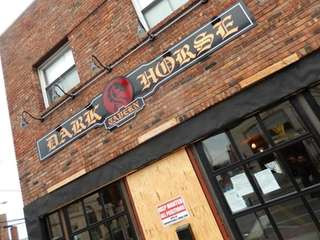 The unfinished storefront of Dark Horse Tavern in
