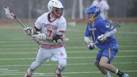 Smithtown East's John Daniggelis is defended bt West