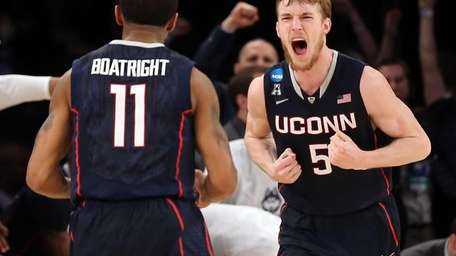 Niels Giffey of the Connecticut Huskies reacts after