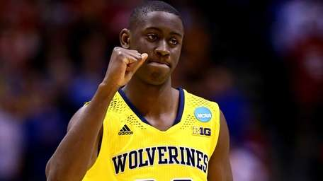 Caris LeVert of the Michigan Wolverines celebrates defeating