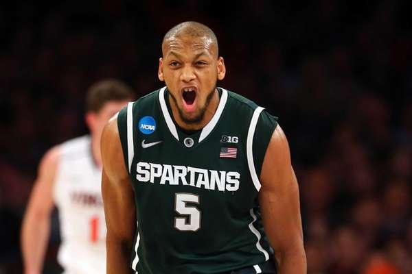 Adreian Payne of the Michigan State Spartans reacts