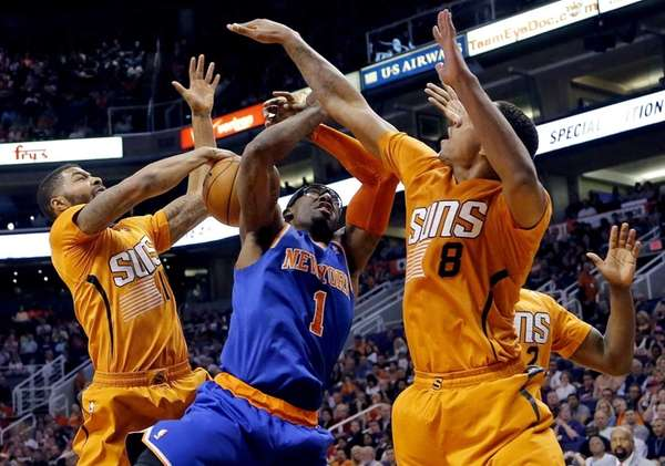 Knicks' Amare Stoudemire has his shot blocked by
