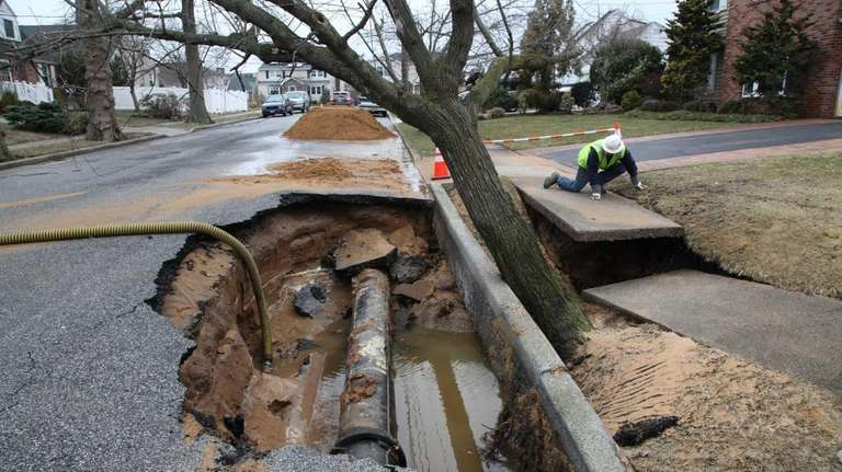Crews work on a sinkhole that formed in