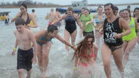 Nearly 400 people plunged into the 37-degree water