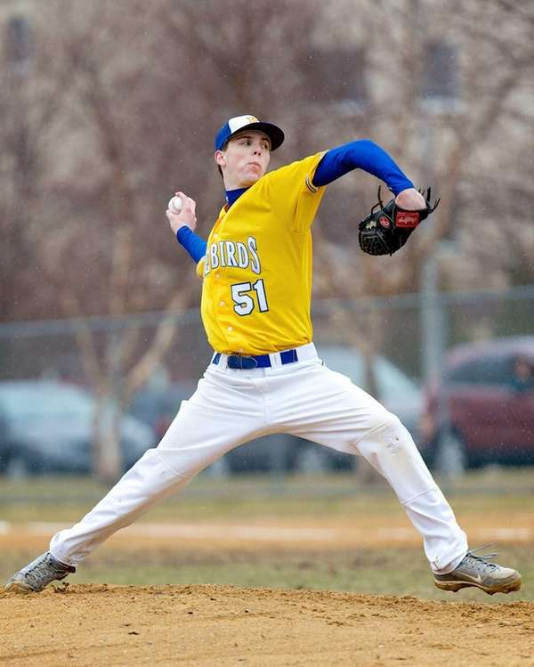 Kellenberg's James Coyne delivers a pitch during a