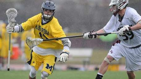 Massapequa's Craig Berge, left, looks to circle around