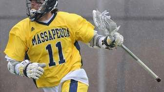 Massapequa's Craig Berge carries behind the net during
