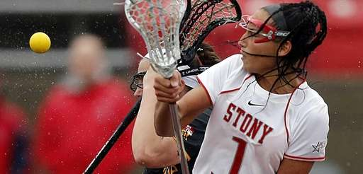 Stony Brook midfielder Michelle Rubino wins the draw