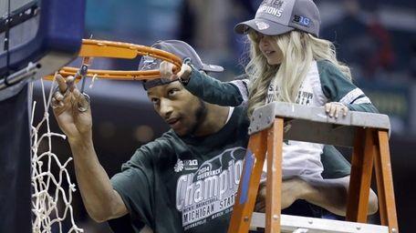 Michigan State forward Adreian Payne cuts the net