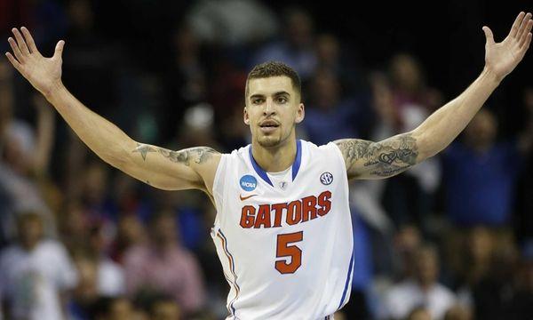 Florida guard Scottie Wilbekin celebrates his basket against