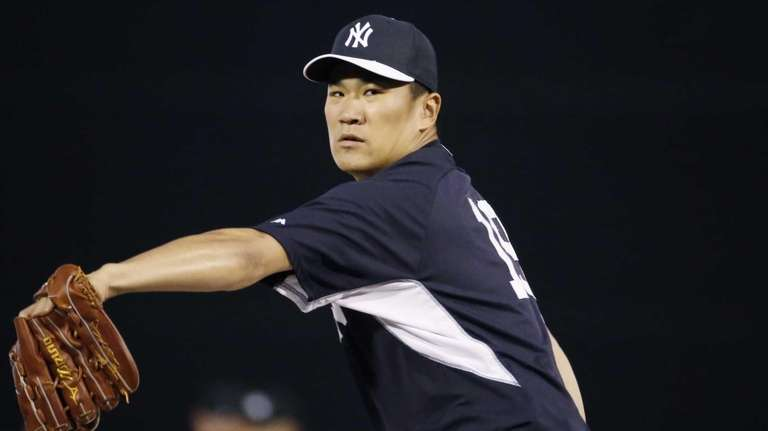 Yankees relief pitcher Masahiro Tanaka delivers a warmup