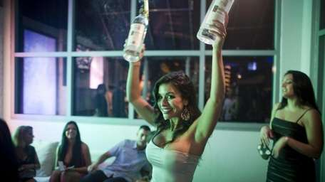A bottle hostess at the club Body English