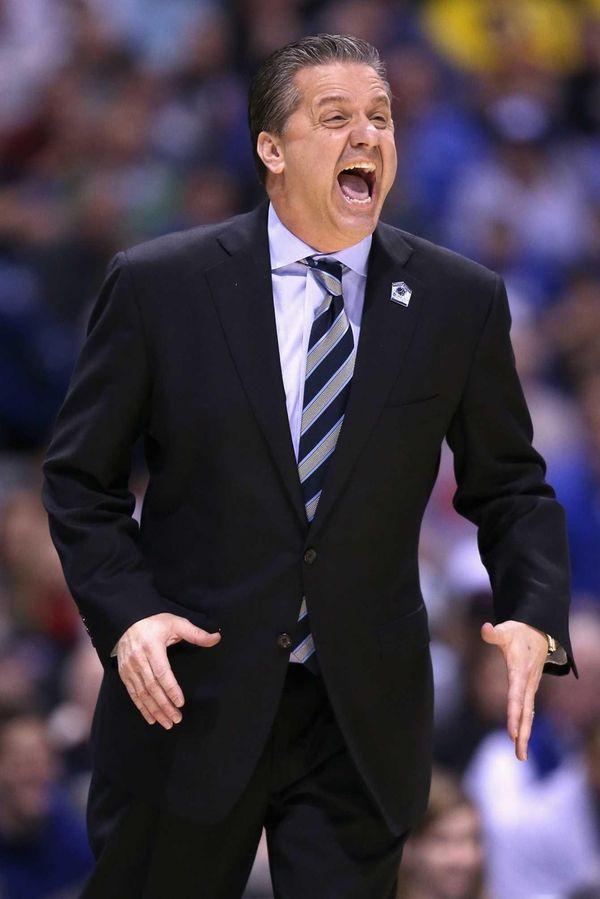 Head coach John Calipari shouts to his players