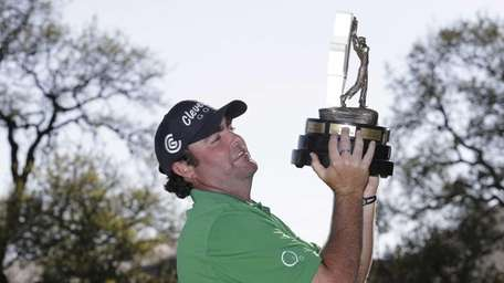 Steven Bowditch poses with his trophy after winning