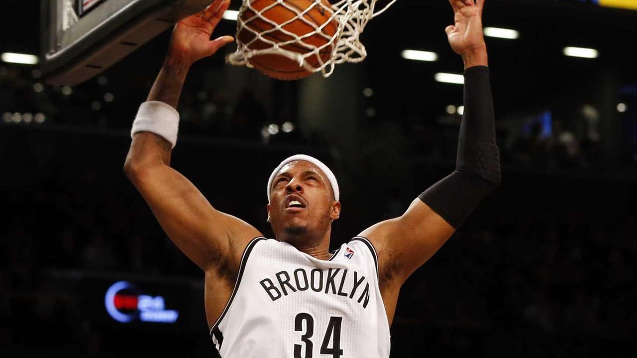Paul Pierce dunks the ball in the first