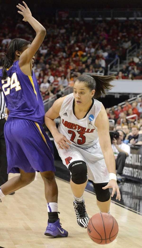 Louisville's Shoni Schimmel attempts to drive under the