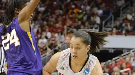 Louisville's Shoni Schimmel attempts to drive under the