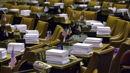 Budget documents are piled on desks in the