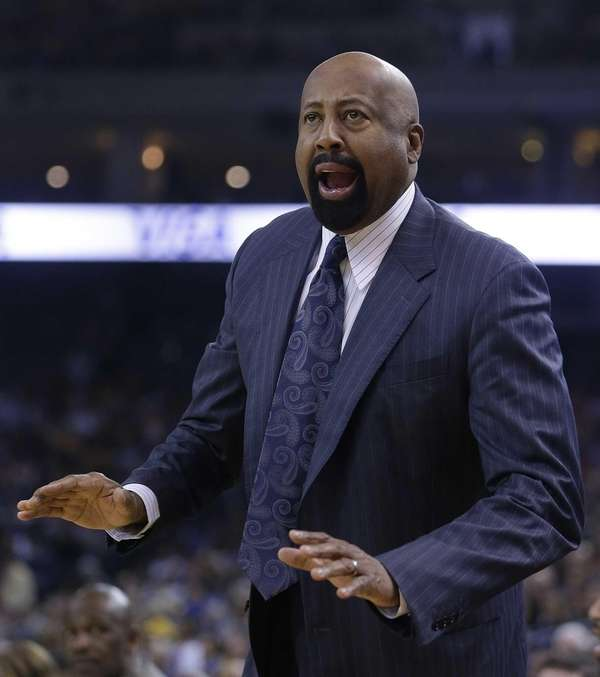 Mike Woodson gestures on the sideline during the