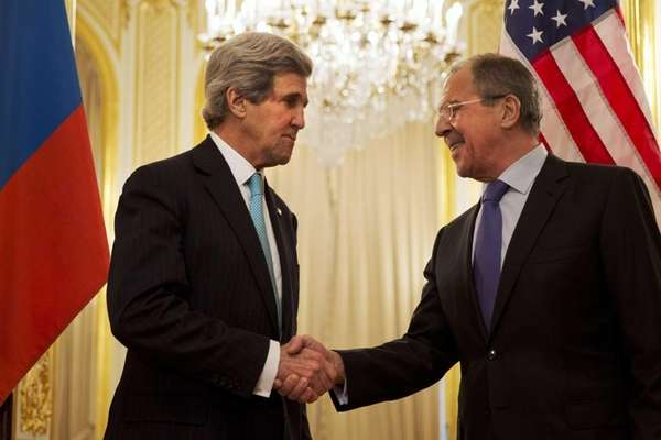 U.S. Secretary of State John Kerry, left, shakes