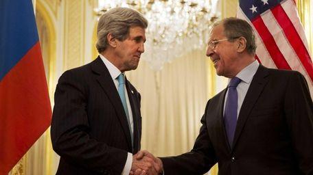 U.S. Secretary of State John Kerry, left, shakes