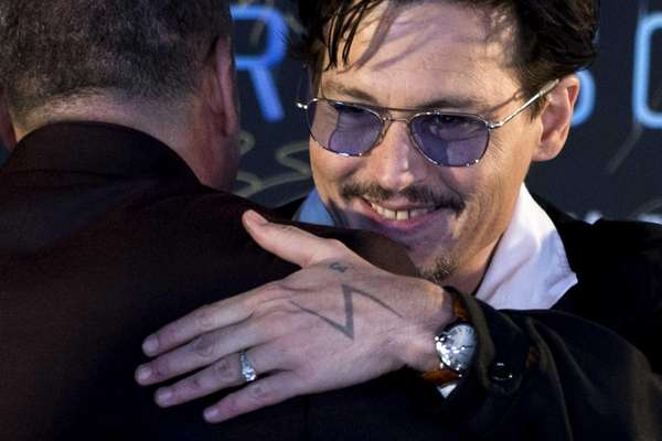 Johnny Depp attends a promotional event for his