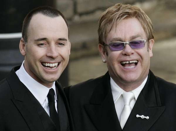 Elton John , right, and his longtime partner,