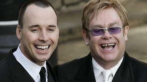 Elton John , right, and his longtime partner,
