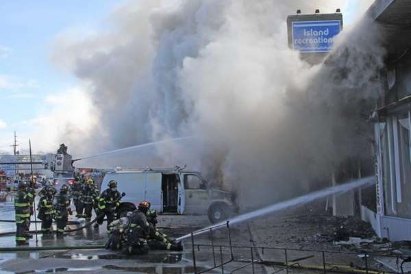 Firefighters from several departments battle a blaze Monday,
