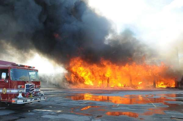 Firefighters battle a blaze Monday afternoon, March 31,