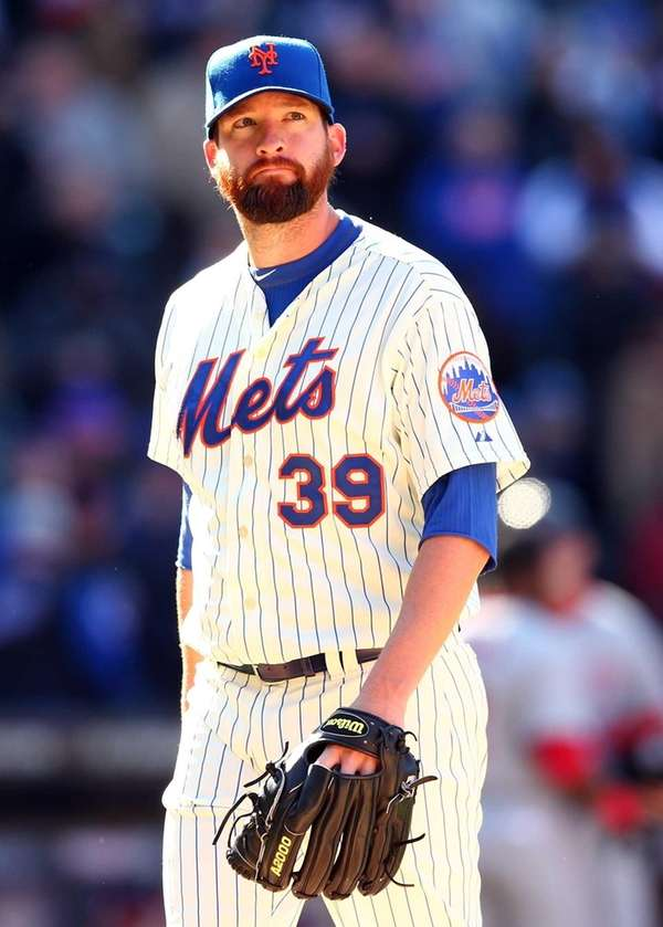 Bobby Parnell of the Mets walks off the
