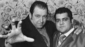 Gorilla Monsoon, left, strikes a clutching pose with