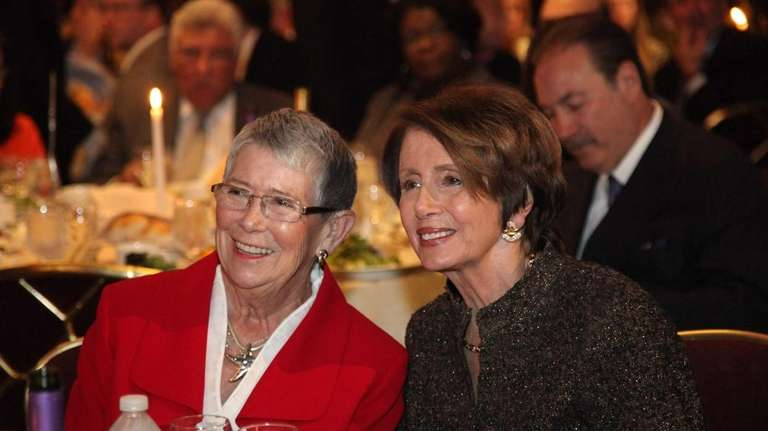 Congresswoman Carolyn McCarthy sits with Speaker Nancy Pelosi