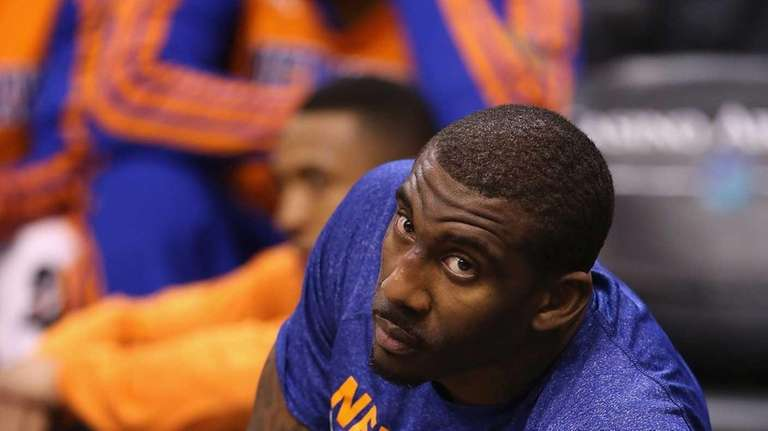 Amar'e Stoudemire looks up from the baseline after